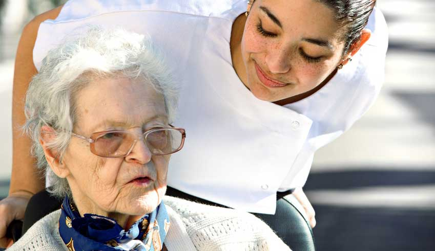 home health aide helping elderly woman with mobility - an activity of daily living