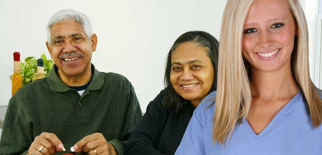 Home health aide with elderly couple